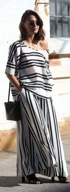 Australia fashion week Spring street style: matching oversized striped top and wide-leg pants with a small black shoulder bag and heeled sandals