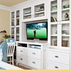 guest bedroom remodel with built-in maple and poplar storage cabinets for TV and drawers