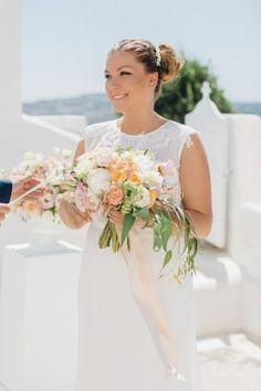 bride during ceremony - photo by Julia Kaptelova http://ruffledblog.com/romantic-santorini-elopement