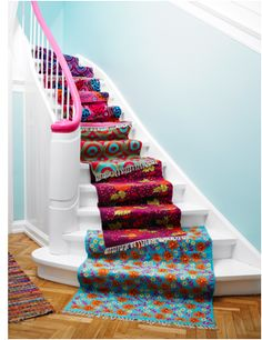 multi color rugs. stairs~
