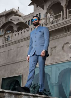 A regular fit sky-blue Bandhgala Suit made with premium quality satin detailing on the collar. With its exclusive metal engraved buttons, this suit set add to the perfect look. Mens Indian Wear, Indian Groom Wear, Indian Men Fashion, Mens Fashion Suits, Man Fashion, Wedding Dresses Men Indian, Wedding Dress Men, Wedding Suits, Dress Suits For Men
