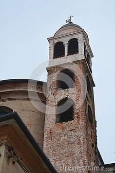 Ossuary temple and its tower against the blue sky in the old town of Bassano del Grappa, lateral view, in Veneto, Italy.