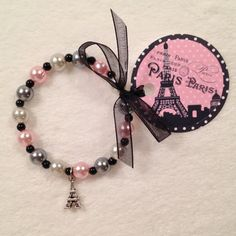 "8 - Meet me in Paris Eiffel Tower Charm Bracelet With Ribbon Tag Birthday Party Favor or Slumber Party Favor 6 1/4"" Bracelet"