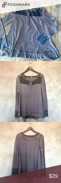 """Free People gray henley top Scoop neck gray Free People Henley with flowy hem. Cuffs at sleeves and darker portion on top. Used but in good condition—minor piling and snags. Cotton, poly and rayon. Slightly thicker than your average henley. Soft, worn in feel. Pit to pit about 19"""". About 28"""" long. Free People Tops"""