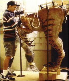 Stan Winston Studio key artist David Monzingo makes an adjustment to a pair of raptor legs for THE LOST WORLD.