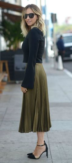 Emily Schuman + sleek + elegant + ultra feminine + gorgeous pleated skirt + bell sleeved crop top + heels + classy winter style + love the simplicity of this look!  Top: Elizabeth and James, Skirt: Club Monaco, Shoes: Zara.