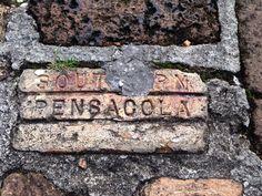 Local brick in a downtown sidewalk.