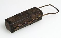 Portable Reliquary Case Date: ca. 1400 Culture: French Medium: leather (cuir bouilli), boiled and tooled, traces of gilding Dimensions: Overall: 4 15/16 x 1 5/16 x 13/16 in. (12.6 x 3.3 x 2 cm) leather case only: 3 1/8 x 1 5/16 x 13/16 in. (8 x 3.3 x 2 cm)