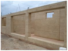 Rammed earth windows for solar heat collection...  http://www.rammedearthnational.com.au