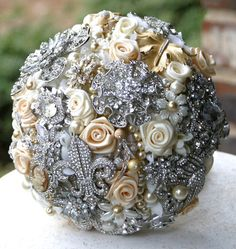 Victorian brooches cover this ball. Would be fun to make. Something different that could be pretty :)