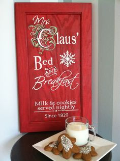 This sign is hand painted on a recycled solid wood cabinet door. It is red and says Mrs Claus Bed & Breakfast. Milk and cookies served nightly. Christmas Wood, Christmas Signs, Little Christmas, Christmas Projects, Winter Christmas, All Things Christmas, Holiday Crafts, Holiday Fun, Christmas Holidays