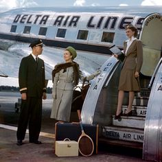 1947 Stewardess Summer Uniform.  Also of note is how lovely the dress of the passenger.  Very few people dress any longer.  That's a good thing and yet it's a little disconcerting to see people traveling in tank tops and flip flops.  :(