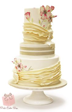Wedding cake with ruffles, hand-pained flowers and 2d cutout flowers.