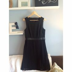 H&M black cocktail dress 100% polyester black belt with pleated bottom. Back has a nice cutout. Worn once. H&M Dresses