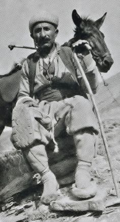 A peasant from the Dersim region, in everyday outfit, anno 1937.  Ethnic group: Alevi Kurd (Zaza).  Mind his peculiar shoe-ware (provided with a rubber sole, recycled from worn-out tires).  The Dersim region contains the actual Tunceli province, and some neighbouring districts of the Elazığ and Bingöl provinces.