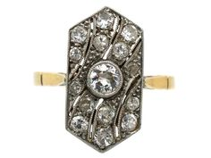 A wonderful and beautifully made Art Deco ring. It has a central diamond with diamond set waves sweeping past it. The shank is 18ct gold and the top is platinum. It is in amazing condition and would make a most unusual engagement ring.