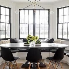 Black and White Bay Window with Built In Banquette and Oval Dining Table