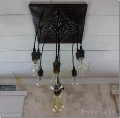 DIY Tutorial - How to Make a Bare Edison Bulb Chandelier from a Thrift Store Tin Tile  #recycle