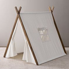 """Canvas A-Frame Tent- this pin connects to a catalog to order these genius tents! This is the kind of """"toy"""" worth spending $ on- it would provide hours of play and last for years. If you are very handy you could make your own- love how it also folds up!"""