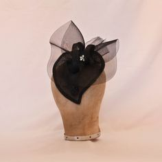 Handmade black heart shaped hat decorated with diamanté details
