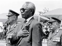 Our hero, our Madiba | South African President Nelson Mandela stands at attention while the National Anthem is sung in 1994. Photo: Getty Images