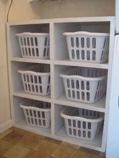 laundry basket storage (linen closet) -- add a counter top for a folding station!