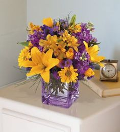 As vibrant as the sky over Tucson. This stunning contemporary cube vase overflows with yellow and lavender flowers, like sunshine emerging through morning clouds. A spectacular floral gift that will take their breath away. Yellow Wedding Flowers, Lavender Flowers, Love Flowers, Yellow Flowers, Beautiful Flowers, Purple Yellow, Purple Vase, Sun Flower Wedding, Color Yellow