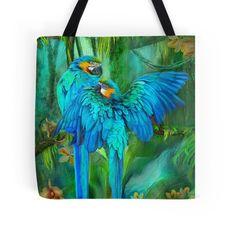 Tropic Spirits - Gold and Blue Macaws designer tote bag featuring the art of Carol Cavalaris.
