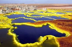 """Dallol Volcano, Ethiopia """"The lowest volcano on land in the world and the hottest place on earth, sulfur, iron hydroxide and ferris chloride color the unusual landscape of the Dallol Volcano. Volcano World, Places Around The World, Around The Worlds, Monte Roraima, Imagen Natural, Different Planets, Blog Voyage, Natural Phenomena, What A Wonderful World"""