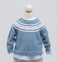 Prince George's sweater worn for the 2015 Cambridge Family Christmas portrait is a piece by another Spanish-based brand, Fina Ejerique. The jacquard sweater is a blend of 30% wool and 70% acrylic.