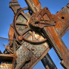Huge gears at the heart of a vintage strip mining machine. Cedar City, Utah.
