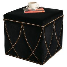 Hardwood square ottoman with black upholstery and patterned nailhead trim.   Product: OttomanConstruction Material: ...