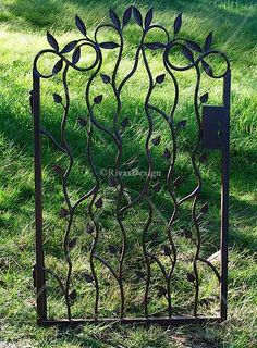 trellis made of branches   Leaf design gate   Wrought iron gates