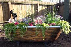 Clawfoot tub with water pump garden attraction