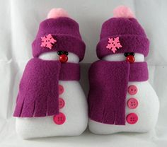 Christmas Decoration Stuffed Snowman Ornaments Flurrie Frizzle in Raspberry Fleece Set of 2. In a set of 2 Flurrie Frizzle decorative handmade ornaments are the perfect decoration for the winter and Christmas holiday season. Made from Blizzard Fleece and stuffed with the best fiberfill to make them soft and plush, they are approximately 6 inches tall and approximately 2 1/2 inches wide at the base. They were originally created to be bowl fillers or tuckin's but I also added a hanging…