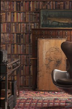 """Fun Wallcovering Ideas"" -- This is bookshelf wallpaper (several more at the click-through), but it's also a pretty almost hidden dark card catalog..."