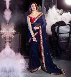 SAREE JACKET DESIGNS 2015 DESIGNER WEAR FOR BOLLYWOOD ACTRESSES JACQUELINE FERNANDEZ BEAUTY QUEEN OF INDIAN CINEMA IN NAVY BLUE GEORGETTE FABRIC DRAPE DRESS