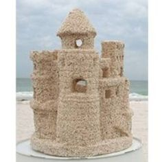 Bring home the fond memories of building sandcastles on the beach. Replica sand castle is created and given a natural sand finish. Glass insert and tealight candle included. Sand Castle Cakes, Homecoming Floats, Nautical Bridal Showers, Ocean Home Decor, Beach Ornaments, Beach Wedding Centerpieces, Tea Light Candles, Here Comes The Bride, Beach Themes