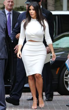 Kim is LOVING a cropped top and high-waisted skirt right now - well, she does look uh-mazing in them. This white two-piece looked fab with Kim's nude heels and wavy 'do.  -Cosmopolitan.co.uk