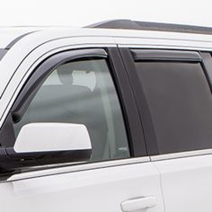 Escalade Side Window Weather Deflectors, Smoke Black:These custom-molded Side Window Weather Deflectors let fresh air in while helping to keep rain sleet and snow out. Plus they help reduce wind noise and sunlight glare.