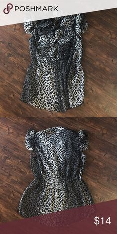 Cheetah Ruffle Blouse Black and gray cheetah button up blouse. Detailing includes a ruffle front and cinched waist. Tops Blouses