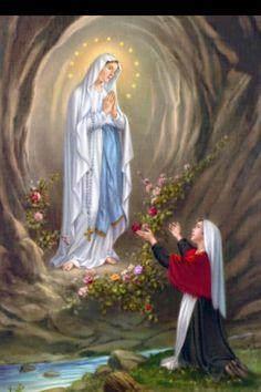 Our Lady of Lourdes...the Virgin Mary appearing to Saint Bernadette Sibourous in Lourdes France.