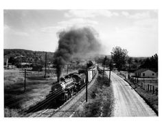 "Missourri - Kansas - Texas (Katy) Railroad's oldest name train: the ""Katy Flyer"" train No. 6 northbound, headed by Engine No. 395, a Pacific type 4-6-2 locomotive with a consist of eight standard heavyweight cars, departing from Denison, Texas enroute to St. Louis"