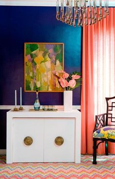 Navy and coral dining room with a retro rug