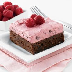 You'll feel like you're floating on cloud nine with this delightful blend of raspberries and chocolate. This chocolate raspberry brownie is topped with a raspberry cream cheese mousse.