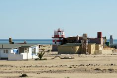 Wlotzkasbaken on coast of Namibia  Wlotzkasbaken is just north of Henties. It is a totally self sufficient community which has no water or electricity supply.