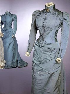 Day dress, 1891. Two-piece, light blue silk rep, comprising high-necked, fitted bodice and skirt decorated with rosettes and bands of fabric. Gemeente Museum, the Hague, via ModeMuze