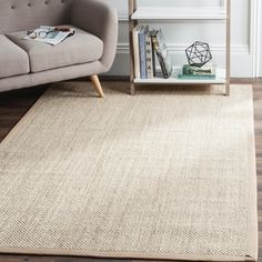 Embrace the tranquility of this richly textured 9' x 12' rug from Safavieh's Natural Fiber Collection. Featuring tightly woven natural marble colored sisal fibers with an ivory linen border, this rug