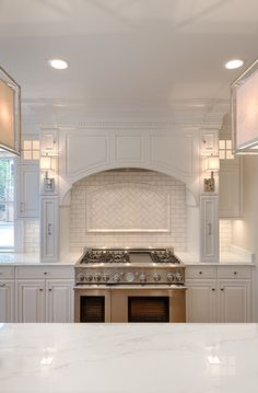 Range and herringbone/brick combo backsplash. Love this kitchen.