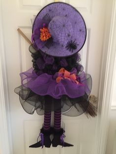 Deco Mesh Witch Wreath by LoversLaneCrafts on EtsyEtsy listing witch wreath with legs, tutu and hatThis witch is decked out in her finest dress and hat ready for Halloween! Her body is made from purple deco mesh, ribbon and black tulle. Halloween Witch Wreath, Halloween Deco Mesh, Halloween Door Decorations, Halloween Projects, Diy Halloween Decorations, Holidays Halloween, Halloween Crafts, Happy Halloween, Fall Crafts